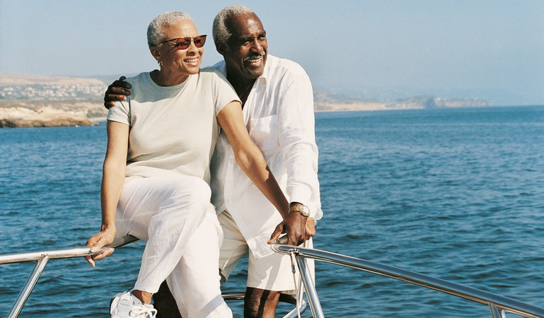 senior couple on sailboat