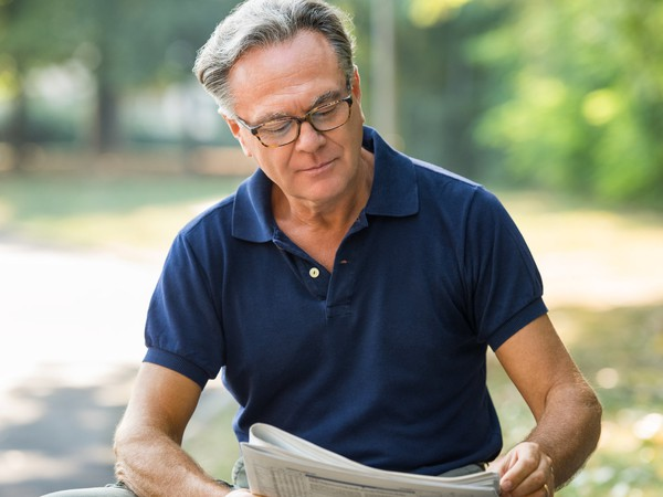 senior man reading the paper_ss myths_GettyImages-612716562