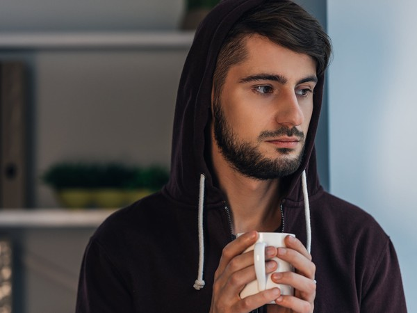 serious man with hoodie_GettyImages-514380024
