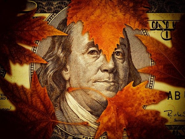 Ben Franklin on $100 bill with leaves