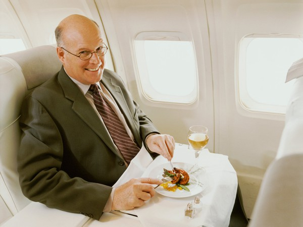 Smiling Man Airline First Class Fly Elite Status Getty