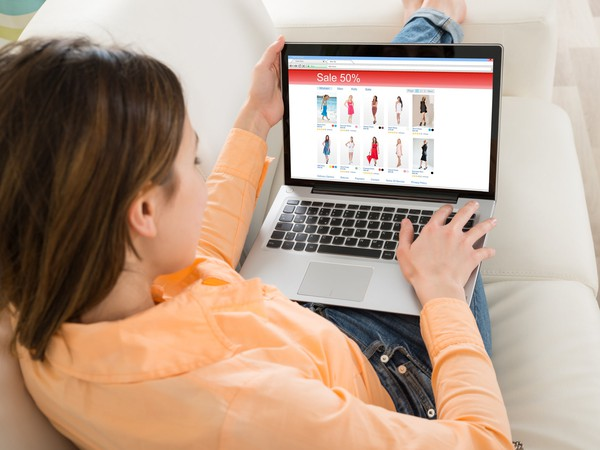 Woman shopping online with a laptop.