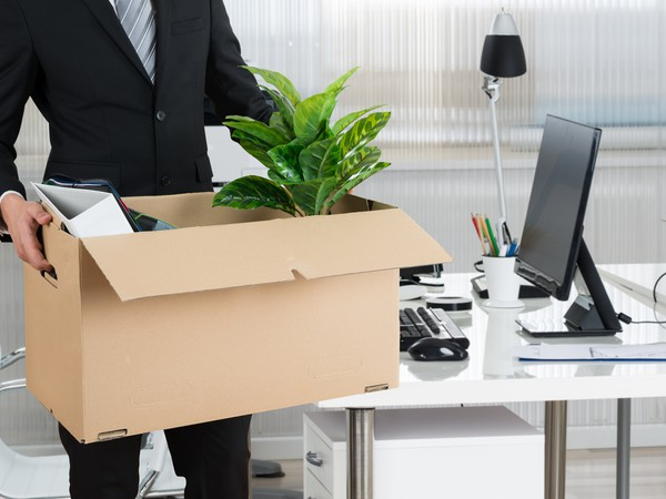 Business man with box of belongings --GettyImages-618526794