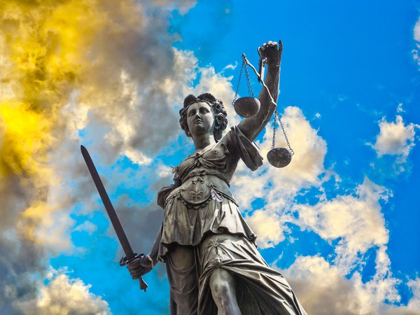Lady justice in the clouds