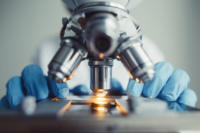 A microscope examining a laboratory slide.