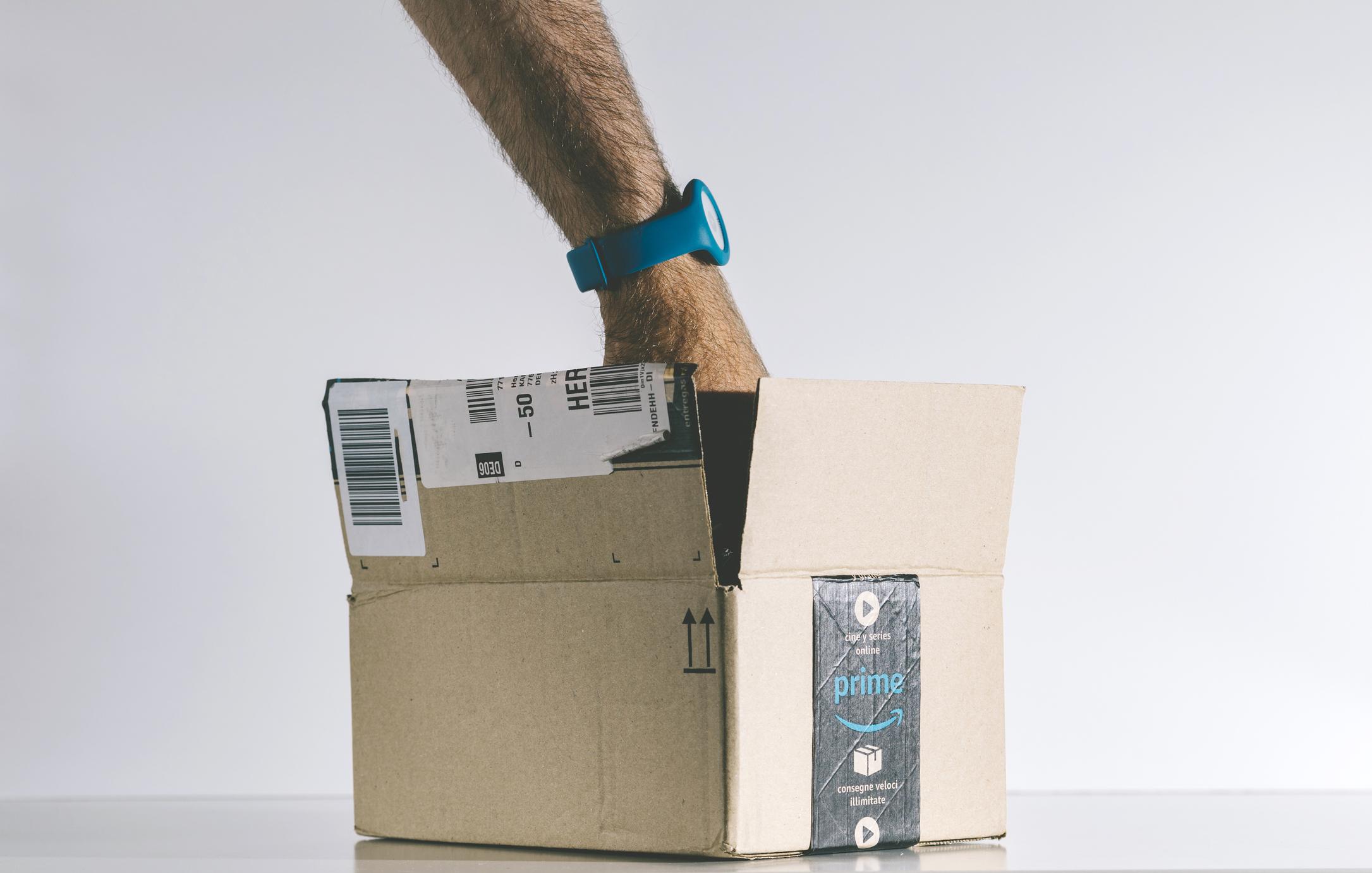 Hand inside of an open Amazon box