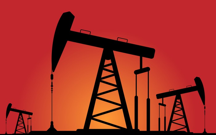 Oil pump silhouettes on an orange background