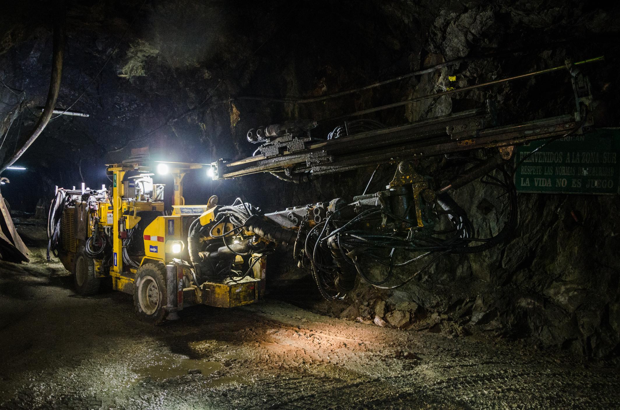 Heavy mining machinery underground.