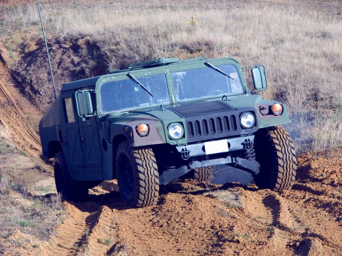 A military Humvee driving off road.