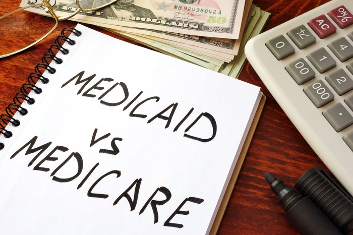 Medicaid vs. Medicare on a notepad