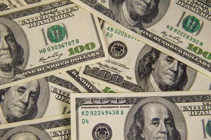 Hundred dollar bills scattered.