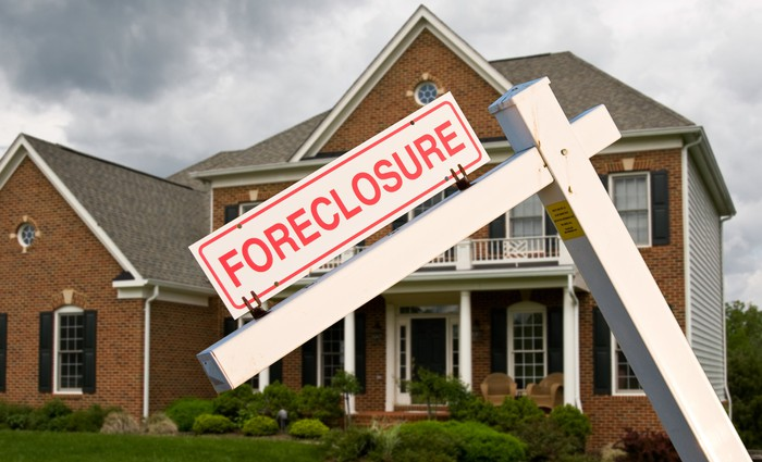 House with foreclosure sign in front.