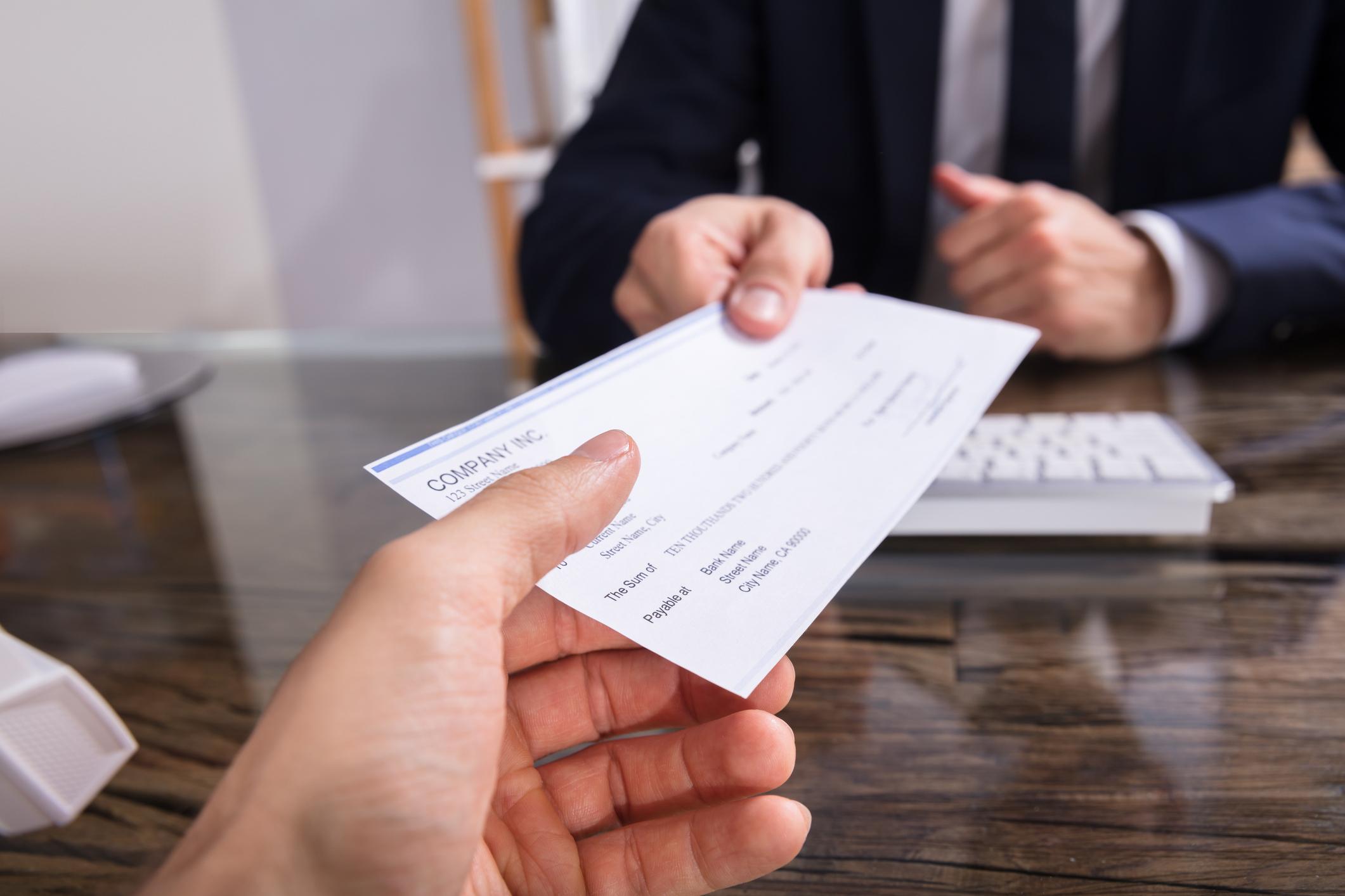Handing ovder a check