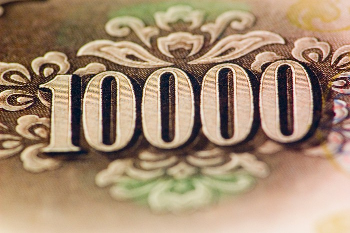 Close-up of the number 10,000 on a $10,000 bill.