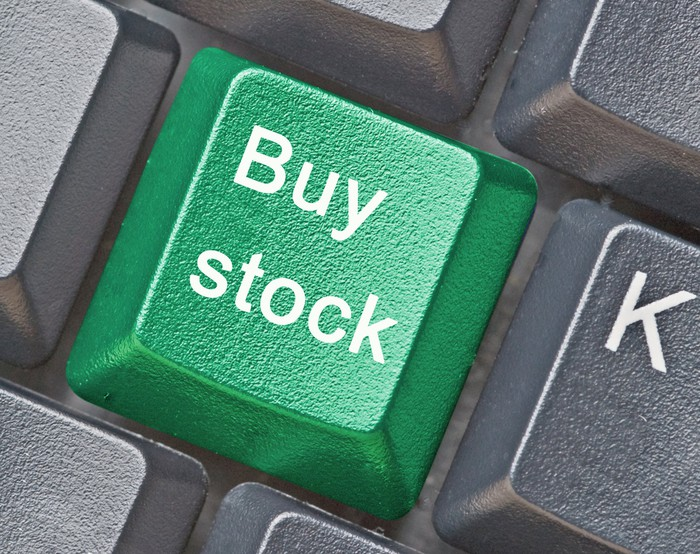 """A keyboard button that reads: """"Buy stock."""""""