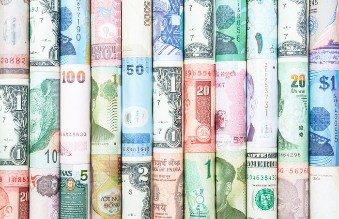 Rolled up bills from different currencies around the world