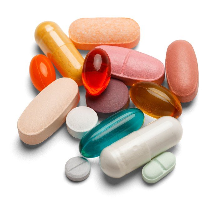 Drug tablets and capsules in different sizes, shapes, and colors.