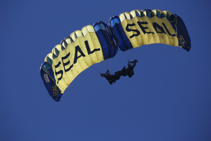 A Navy Seal parachuting.