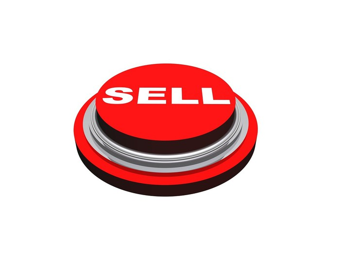 """bright red button labeled """"sell"""""""
