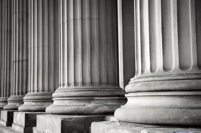 Row of columns in black and white.
