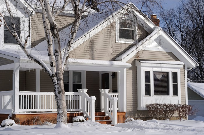 A suburban house in winter.