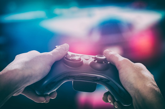 Close-up of hands holding video game controller