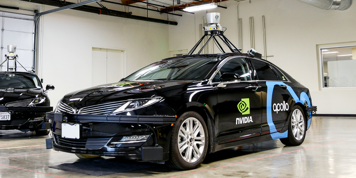 Car with lidar technology on top of it.