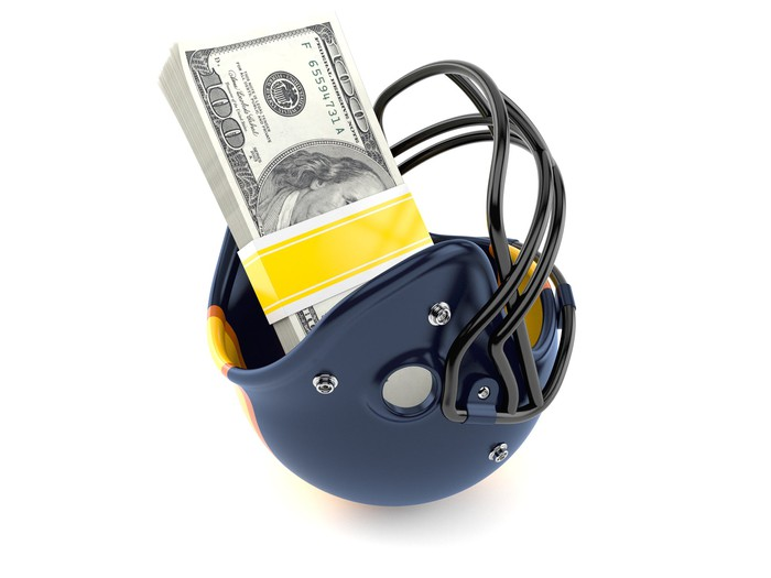 Football helmet with money