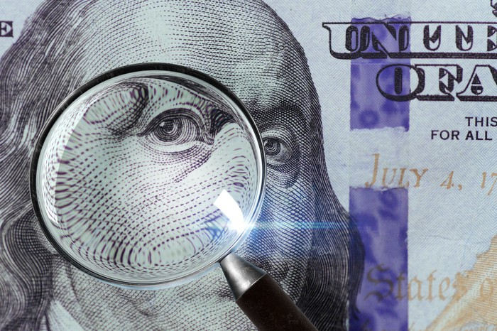 A 100 U.S. bill under a magnifying glass