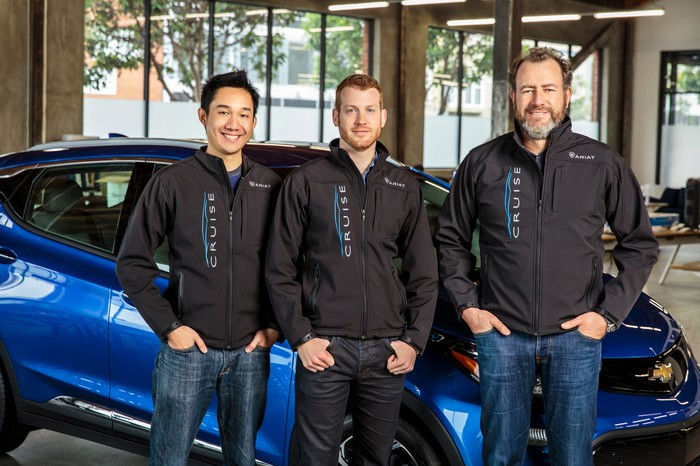 Daniel Kan and Kyle Vogt with GM president Dan Ammann