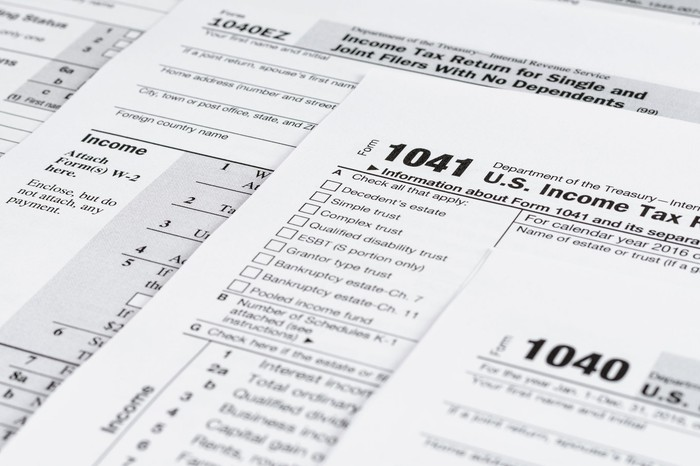 Various tax forms partially covering each other