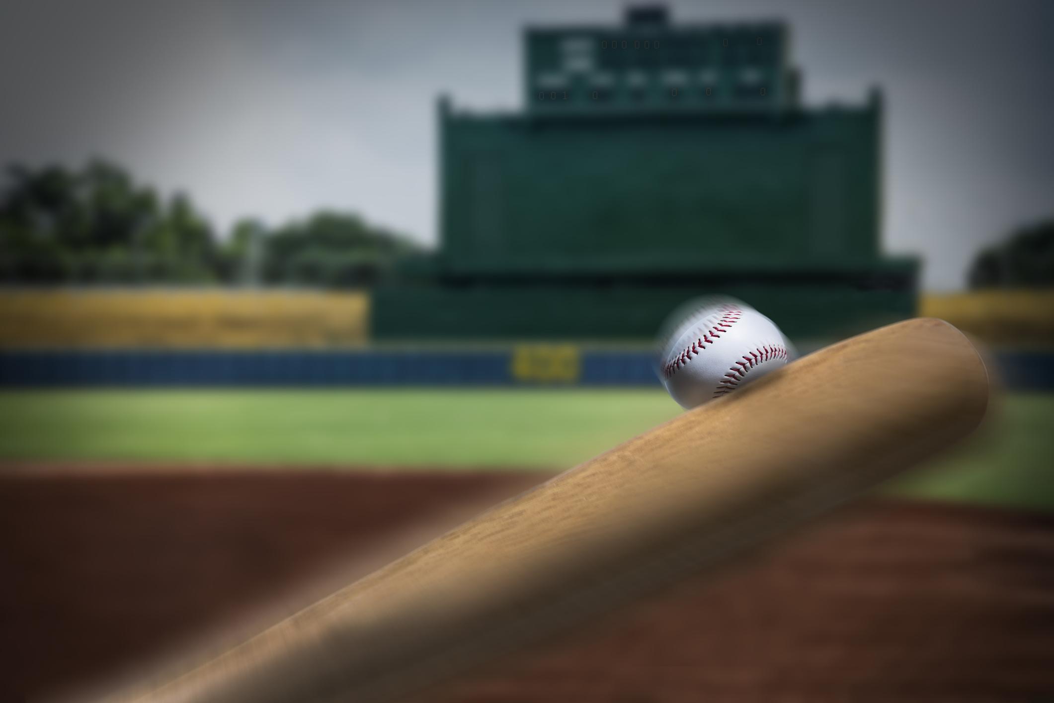 Baseball bat hitting a ball.
