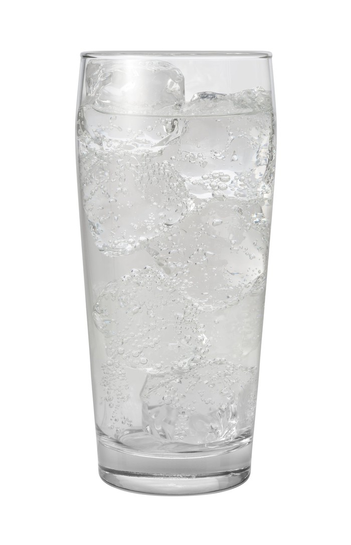 A glass of sparkling water on ice.