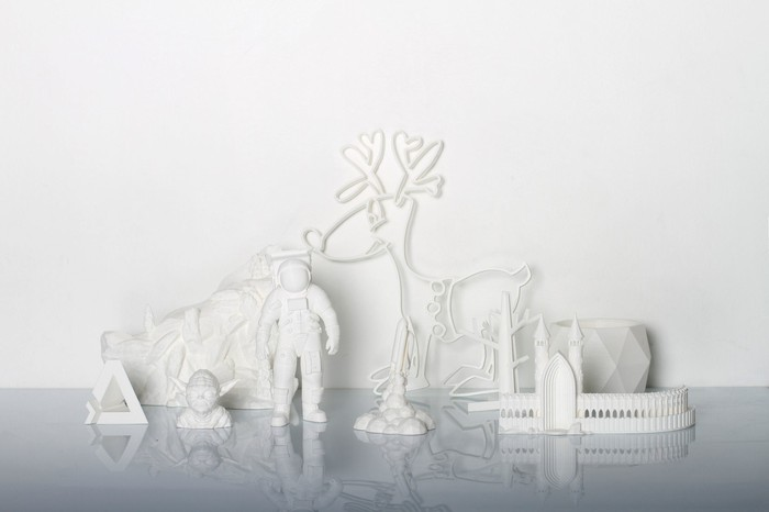 A collection of 3D-printed objects in white plastic