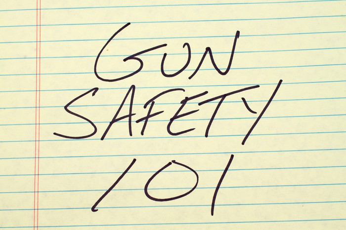 """GUN SAFETY 101"" written in black on yellow lined paper"