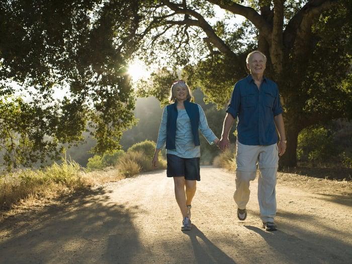 Older couple taking a walk.