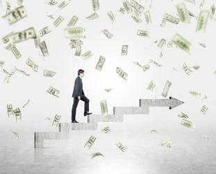 Businessman Rising Chart Falling Money Getty