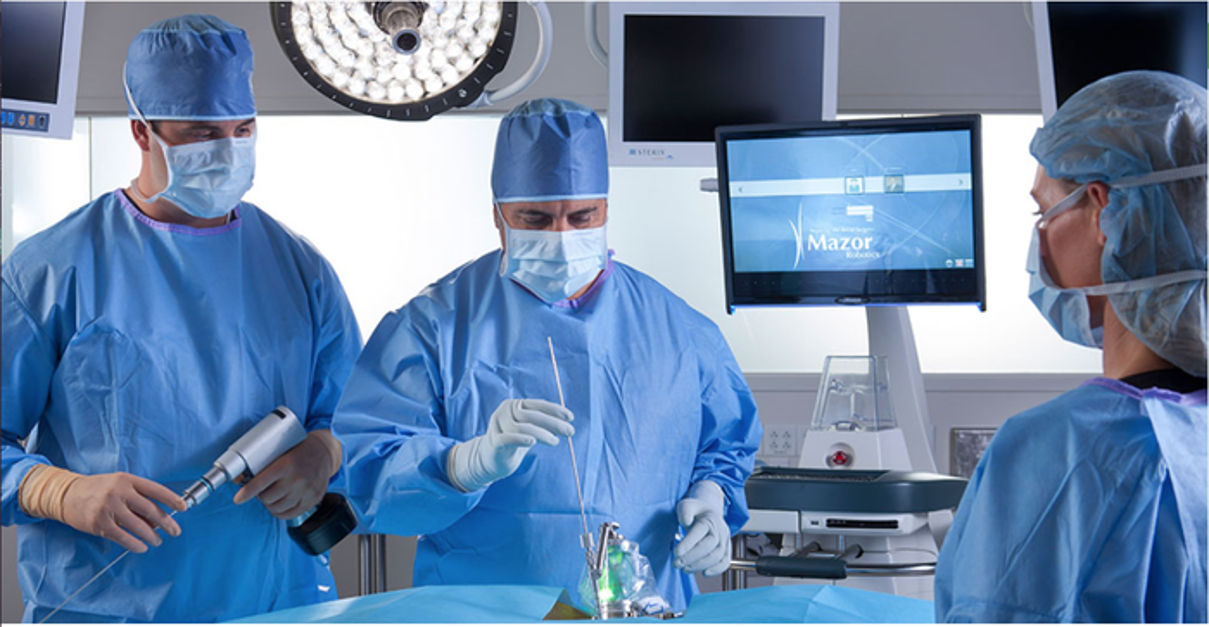 Neurosurgeon using one of Mazor's robotic surgery systems.