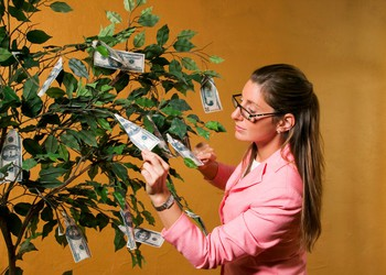 Woman Picking Money Tree Getty