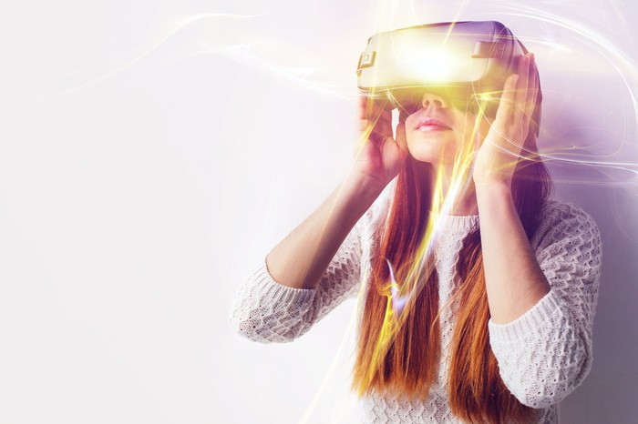 Young woman wearing a virtual reality headset.