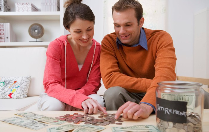 A married couple counting their retirement money.