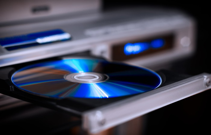 DVD player with a disc in its open tray
