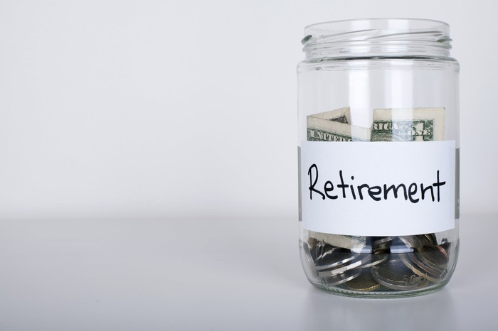 """Jar of money with """"retirement"""" on the label."""