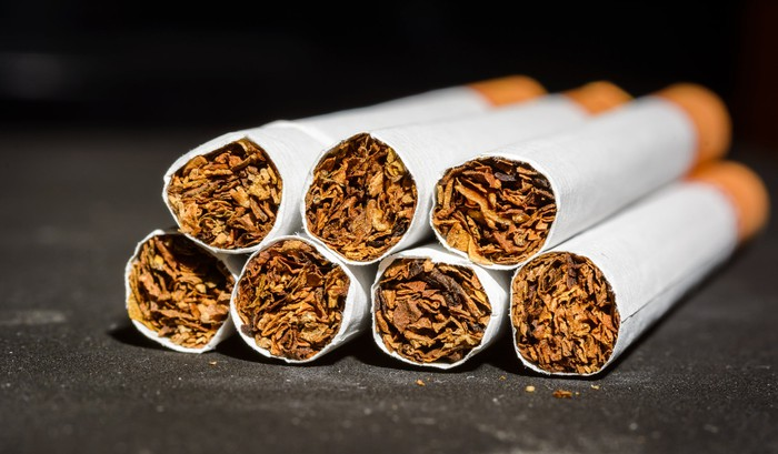 Seven cigarettes stacked lengthwise.