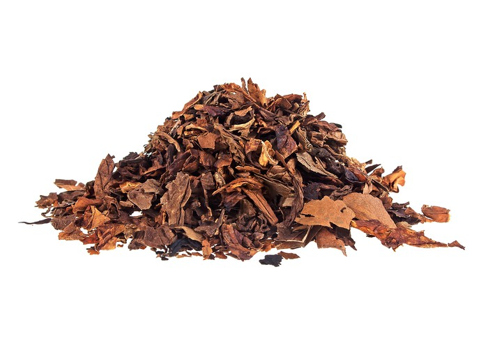 A heap of dried tobacco leaves.