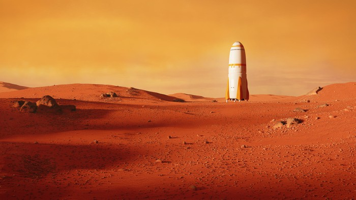 A rocket sitting on a plain on Mars.