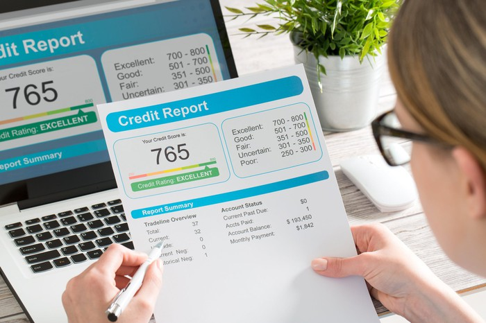 A woman reviews her credit report.
