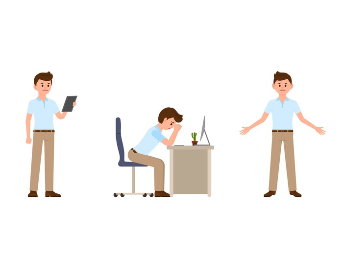 Cartoon figure of a worried man looking at a handheld computer, with head in hands while sitting at a desk, and with arms open.
