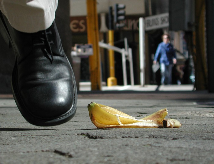 Man avoiding banana peel