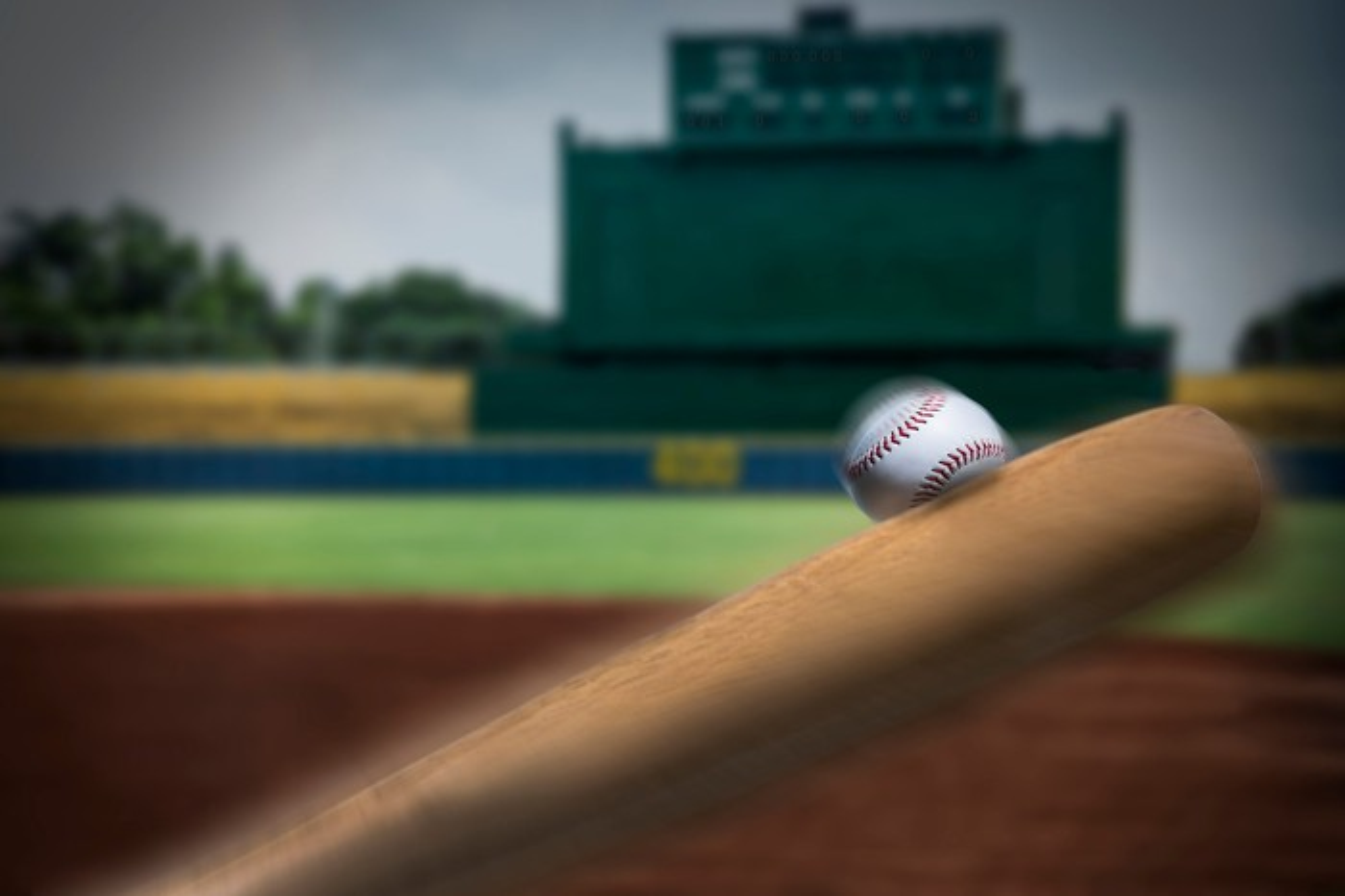 A baseball bat hitting a ball.